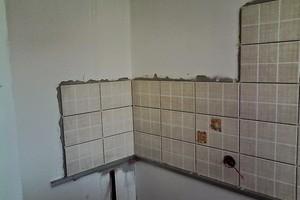 Укладка плитки на стену кухни
